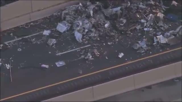 Truck Overturns, Spills Trash on Highway