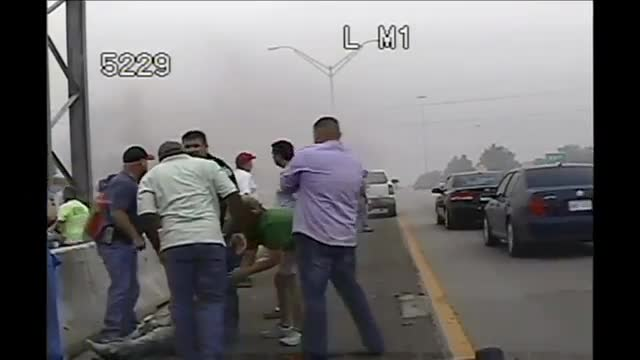 Officer Helps Save Woman From Burning Car