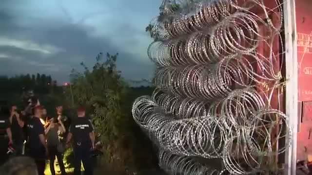 Hungary Blocks Border Gap with Razor Wire