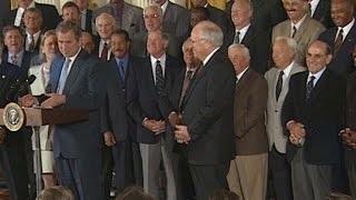 President Bush shares a laugh with Yogi Berra