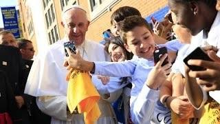 Catholic school children greet Pope Francis in Harlem