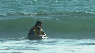 Disabled people take on surfing in El Salvador