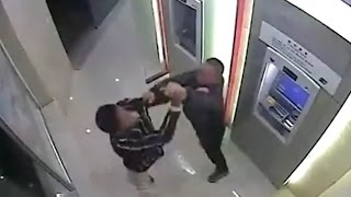 Robber beaten by victim in ATM Room: Caught on Cam