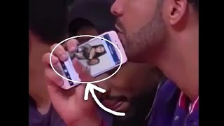 Drake Caught Looking At Photo Of Nicki Minaj & Meek Mill Together!