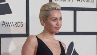 Miley Cyrus Flaunts Familiar Bling