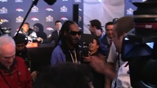 'Reporter' Snoop Dogg Visits Panthers, Broncos