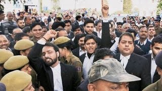Lawyers attack journalists at Patiala House Court. Snatch mobiles, delete videos