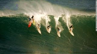 Eddie Aikau Memorial: Elite surfers take on giant waves in Hawaii