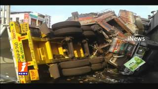 2 Lorry Hits Falls From Flyover in East Godavari dist  iNews