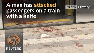 Man knifes rail passengers at German train station