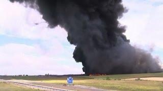 Raw: Firefighters Battle Spain Tire Blaze