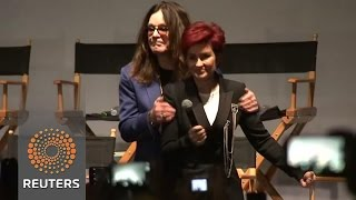 Split-rumour Ozzy and Sharon Osbourne hug on stage