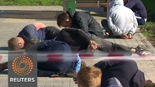 Russia cemetery brawl