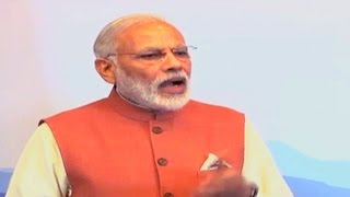 Combating menace of black money and tax evasion is our shared priority: PM Modi