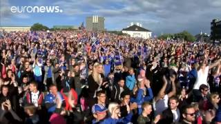 Thousands of Iceland fans give football heroes a spine-tingling welcome home with Viking war chant