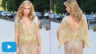 Paris Hilton shines in bold golden gown at the Louis Vuitton party