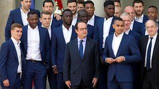 Hollande greets France squad at Elysee Palace