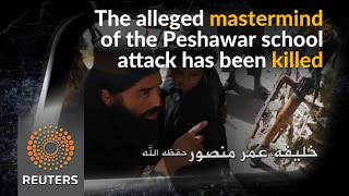 Pakistan says leader of Peshawar school attack killed in US drone strike