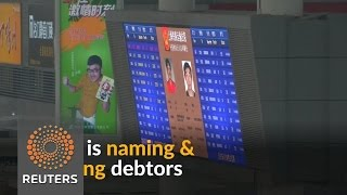 Shame on you! China uses public billboards to expose runaway debtors