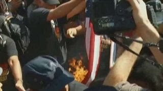 Protesters at RNC attempt to burn the American flag