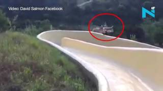 On Cam: Man flies off a water slide into a rocky cliff