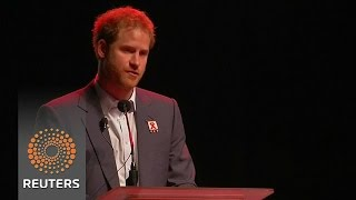 Prince Harry talks about his mother's symbolic Aids gesture.