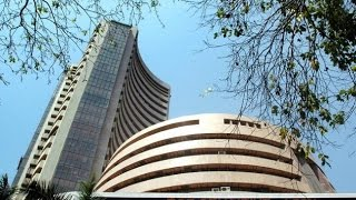 Sen$ex down 67 points, Rupee trading lower by 13 paise