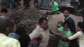 On cam: Angry locals thrash cop in Surat