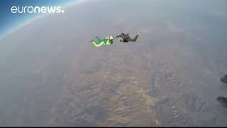 Skydiver Luke Aikins makes parachute-free jump from from 7.6km (25,000ft)