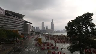Hong Kong shuts down as Typhoon Nida sweeps across China