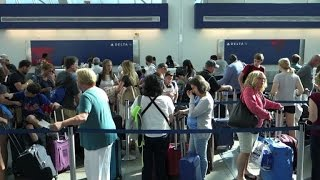 Delta grounding lifted, but travel chaos not over