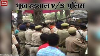 कामगारों और पुलिस के बीच धक्का-मुक्की