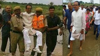 Shivraj Singh Chouhan carried by cops in flood affected areas