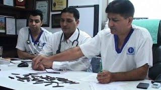 Raw: Indian Policeman Swallows 40 Knives