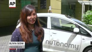 World's First Self-Driving Taxis Start Pick-Ups