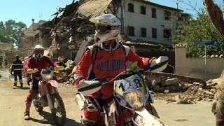Volunteer bikers scour Italy's trails for quake survivors