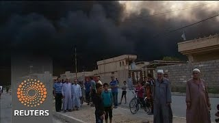 Dark skies over Iraqi town freed from Islamic State