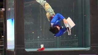 Performers enact daily routines in underwater tank in London