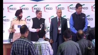 Sanjeev Shukla, SP Raigarh, Chhattisgarh Police receiving FICCI SMART Policing Award
