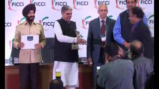P  Vijayan, DIG Kerala Police receiving Special Jury Award at FICCI Smart Policing Award