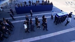 Shimon Peres' coffin carried out to burial site