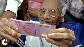 PM Modi's Mother Visits Gujarat Bank to Exchange Currency Notes