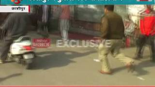 Police use batons outside the polling booth in kashipur