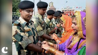Women tie Rakhi to Indian soldiers for their selfless service