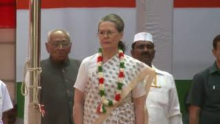 Congress President Smt. Sonia Gandhi hoists the flag at AICC