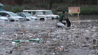 Drain breaks banks after heavy rains in Jammu