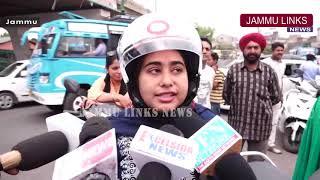 Traffic Police distributes helmets