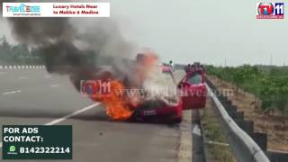 CAR CATCHES FIRE AT ORR BRAHMANAPALLY  HYDERABAD TV11 NEWS  18TH MAY 2017