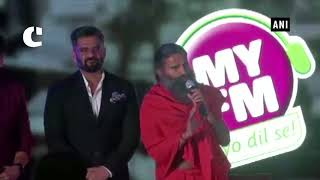 Yoga Guru Baba Ramdev performs Yoga with actor Suniel Shetty