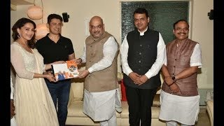 BJP chief Amit Shah meets Bollywood actor Madhuri Dixit during campaign